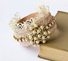 Attractive bracelet with lace, braid  and brooch.