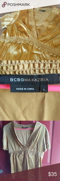 BCBG Max Azria golden silk top Gorgeous gold top with a dramatic v-neck, gathered trim around neck and under bust. Perfect to wear next to glowing summer skin! Purchased at the BCBG store in Las Vegas and wore it only once. It's been dry-cleaned and hanging in the closet till now. 95% silk, 5% spandex. BCBG Max Azria Tops Blouses