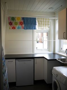 laundry room with clothes rack in the ceiling - saves lots of space! Work Surface, Modern Kitchen Design, Valance Curtains, Laundry Room, Kitchen Cabinets, Space, Home Decor, Ceiling, Clothes