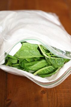 If your greens are wilting within a few days of bringing them home from the store, you can prevent it with this quick storage tip. First, wash the greens thoroughly in cold water. Submerge them in bowl full of cold water at least three times before spinning them dry. Then line a resealable bag or tupperware container with a paper towel. Transfer the greens, then top them with another paper towel. Seal the bag or pop the lid on the tupperware and store in the fridge.
