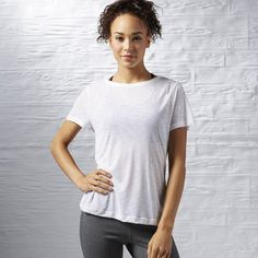 Reebok Workout Ready Light Slub Textured Tee ($25) ❤ liked on Polyvore featuring activewear, activewear tops, apparel, reebok sportswear, reebok, tail activewear, reebok activewear and logo sportswear