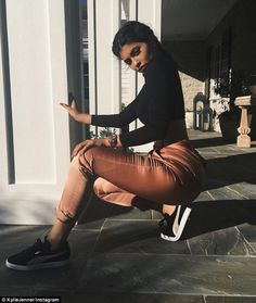 You're wearing shoes? Kylie Jenner shows off more than just the new style of her Puma sneakers in a bootylicious ensemble   Daily Mail Online