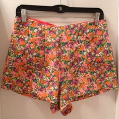 High waist floral print shorts Super cute with front pockets, zipper back closure, rayon & polyester material, can dress them up or down mixx Shorts
