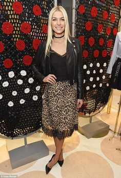 A walk on the wild side: Jessica Hart sported a leopard print skirt and black leather jacket as she posed at the RED Valentino launch in London on Saturday night
