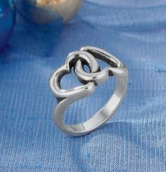 Two interlocking hearts represent the infinite bond formed by true love. #jamesavery #jewelry