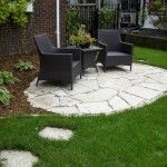 Great Backyard Patio Ideas with stone floor with black chair and coffee table green grass in small garden