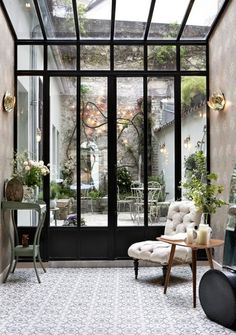Amazing interior style. Love the windows and mix of furnitures!
