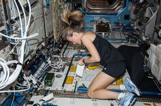 NASA astronaut Karen Nyberg, Expedition 36 flight engineer, works in the Destiny laboratory of the International Space Station.