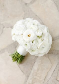 Ranunculus -- Solid White Ranunculus! Love this bouquet! See the wedding on SMP: http://www.StyleMePretty.com/little-black-book-blog/2014/02/03/outdoor-jewish-wedding-at-bel-air-bay-club/ Elisabeth Millay Photography