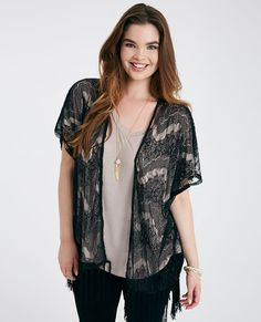 This delicate kimono features a sheer eyelash lace body, knotted fringe trim, and a flowy open design.