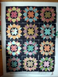 Swoon quilt with charcoal background