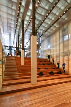 $40 million for 23,000 square feet of retail space? Even by New York City standards, the sum was certainly large enough to create a great deal of interest in Prada's flagship store well before it opened.  The store's main design component is the half pipe-like wooden curve that connects the two floors visually. On the Broadway side, the curve has steps and serves as a place for clothes to be shown. According to OMA, this portion of the half pipe also serves as place for people to try on…