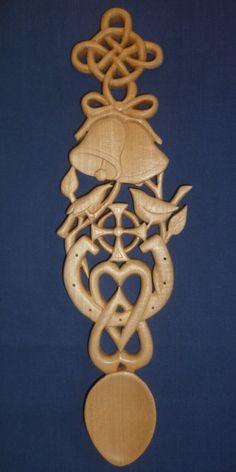 Celtic wedding love spoon with lovebirds and cross. www.adamking.co.uk