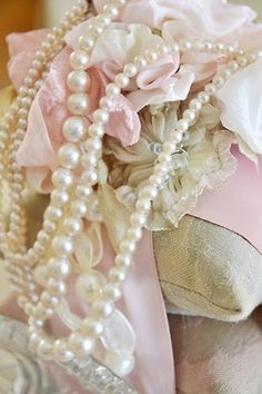 Pearls, strings of them.  Another pure passion.
