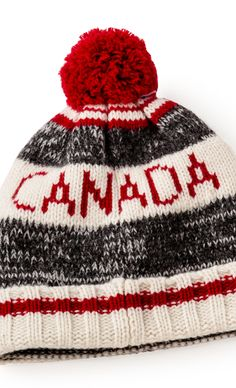 Staying warm is a whole lot easier with pom poms and cabin stripes toque