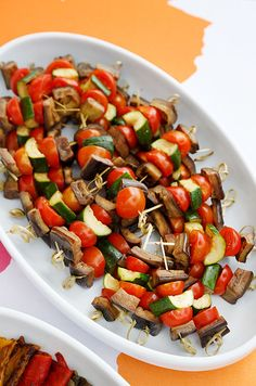 Eggplant, tomatoes and zucchini make colorful kebabs. Add in some grilled chicken for your meat-eating guests.