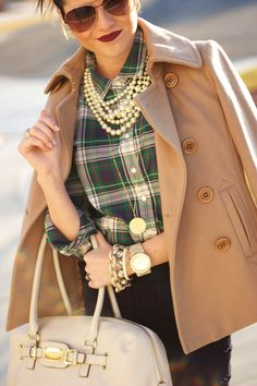 How to dress up a plaid shirt: black pencil skirt, camel coat, pearls and riding boots. Never would have put these together, but it works!