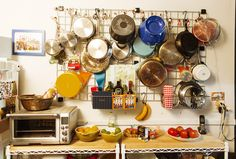 Pots and pans hanging. Look at all of those colors. http://theselby.com/galleries/ambra-medda-at-home-in-new-york-city/