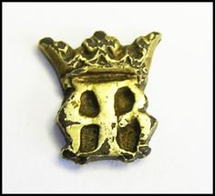On offer is this jolly rare ring bezel, dating to the early 16th century. It depicts the crowned letters A.B. judging from the style and a similar crowned A.B. dating to the period of King Henry VIII. The initials likely stand for Queen Anne Boleyn! We have a very little left of Anne Boleyn, that which does survive was mainly hoarded by her daughter Queen Elizabeth I. Such a bezel may have even been part of a silver gilt clothing hook, in which case it could be directly linked with the…