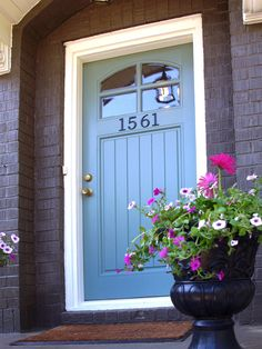 Blue front door. I really like this color!