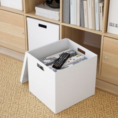 TJENA Storage box with lid - white. This box is big enough for storing toys and games, and durable enough for everyday use. Choose a colour you like – keep it as it is or be creative and design your own look. Kallax Shelving Unit, Shelves, Ikea Boxes, Childrens Desk, Kallax Regal, Storage Boxes With Lids, Ikea Family, Ikea Storage, Box With Lid