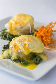 Eggs Sardou (poached egg on artichoke bottom with creamed spinach and hollandaise sauce)