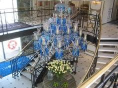 The grand chandelier from the historic Tavern on the Green in NYC hangs in the lobby of the S.S. Antoinette.