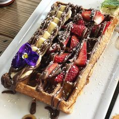 (7.7/10) amazing Waffletella - waffle topped with and ofc #nutella