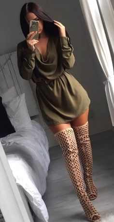 Olive green flowy dress for a cute night out (or club) summer outfit with open cut mesh thigh high boots.