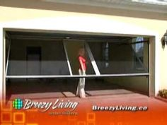 "The Breezy Living Screen uses a vertical and horizontal track system mounted directly inside the existing door, leaving the floor track-free.     The system is fully spring loaded, so raising and lowering the Breezy is a snap! Featuring a ""door-within-a-door"" system, Breezy Living Garage Door Screen is one of the most innovative and unique screen systems for garages and offers an exit door without the need to retract the entire screen. Breezy Living Screens keep out pests and blowing debris."