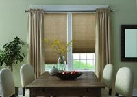 Cellular shades framed with drapery panels.