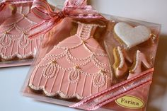 Dress shoes and heart. Looks like a princess theme giftbox of cookies