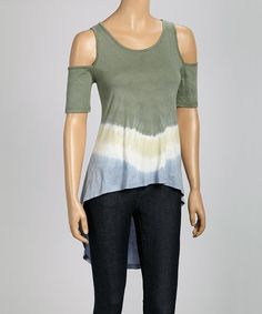 Show off those toned shoulders and solidify style in this cutout top. Seasonal colors and a longer hem in back, make this piece a perfect choice for fashionably casual days.