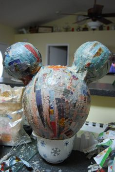Paper mâché to make your own piñata! Looks easy enough!