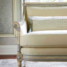 Classic Motifs  Classic Greco-Roman motifs include the Greek key, the crest, the quatrefoil, and the shield. Here a neoclassic-style settee, upholstered in elegant ivory, gets a royal touch, with silver leaf added to highlight the carving on the frame. The bolster is rendered in a Greek key pattern.