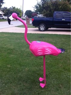I found an amazing local artist who I commissioned to make large metal flamingos.  Each one is unique with its own personality.  The body...