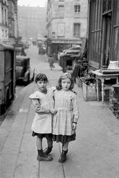 Two friends. 1952 - looks like so much longer ago but I can definitely see a car!