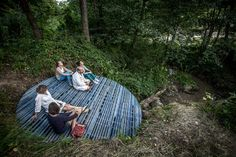 IKA MEDITATION SPOT batlab architects  studio nomad The blue meditation point was the result of the collaboration of the invitees (Studio Nomad, Batlab architects) and Csomópont of the Noise Workshop held in Transylvania, which draws attention to a neglected part of stream Ika. The shape and structure of the 4m disc was affected by the natural conditions provided by the collapsed brook bank. The building is based on a fallen tree, which also giv