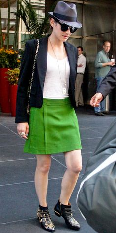 Cotillard stepped out in Manhattan sporting a cropped blazer over a bright green skirt, accessorized with a chain-strap bag, fedora and studded booties.