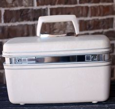 White Samsonite Train Case With Tray & Mirror by GetColorCrazy, $55.00. I used to have my Grandmother's. Wish I had it, now.