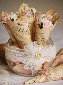 Old music or book paper rolled into a cone and filled with candy.  So simple and easy and wouldn't cost much.  479918_460435077312620_764448755_n