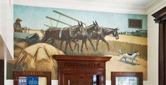 "Inside the Monroeville, AL Post Office is a New Deal mural titled, ""Harvesting"".  This oil-on-canvas painting shows a farmer using a three-mule team to pull a threshing machine across a wheat field.  The artist that painted the mural is Arthur L. Bairnsfather, and the date of the painting is September 1, 1939."