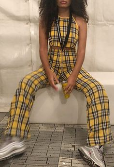 Festival season is officially upon us. One person who has the aesthetic well and truly mastered is ASOS Insider Ebony, with her fierce Clueless-meets-Kill-Bill two-piecer. Yellow tartan is the sunshine-based savior here: in a halterneck crop top and wide-leg pant combo. Chunky silver kicks add a casual street-style element.