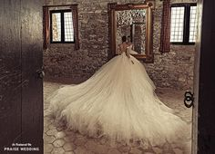 Dramatic long wedding gown trains never disappoint, and this one from Julia Kontogruni