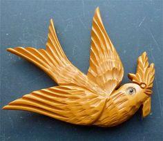 Bakelite bird with branch in mouth | Bakelite Museum