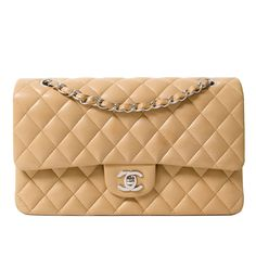 Chanel Medium Creme Double Flapbag | From a collection of rare vintage shoulder bags at https://www.1stdibs.com/fashion/handbags-purses-bags/shoulder-bags/