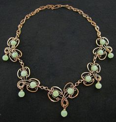 Ornate Copper Necklace Accented With Pale Green Aventurine Beads