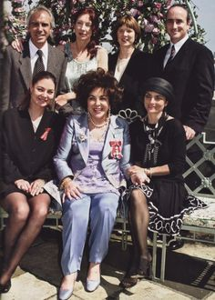 Dame Elizabeth Taylor (2000) with (backrow): son Michael Wilding, Jr., his spouse, Chris' spouse, Christopher Wilding.  On each side of Liz, is daughter Maria Burton and Liza Todd.