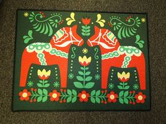 Swedish Dala Horses on Dark Green Door Mat. The size is x The top is 20 oz loop rug. The design is printed with dye sublimation. The edges are bound with a black fabric type material. The mats are made in the USA and we print the pictures ourselves. Floor Cloth, Floor Mats, Green Door Mats, Folklore, Horse Cookies, Horse Rugs, Wooden Horse, Swedish Design, Danish Design