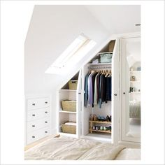 Built in wardrobe and chest of drawers in an attic room to make the best use of the space.